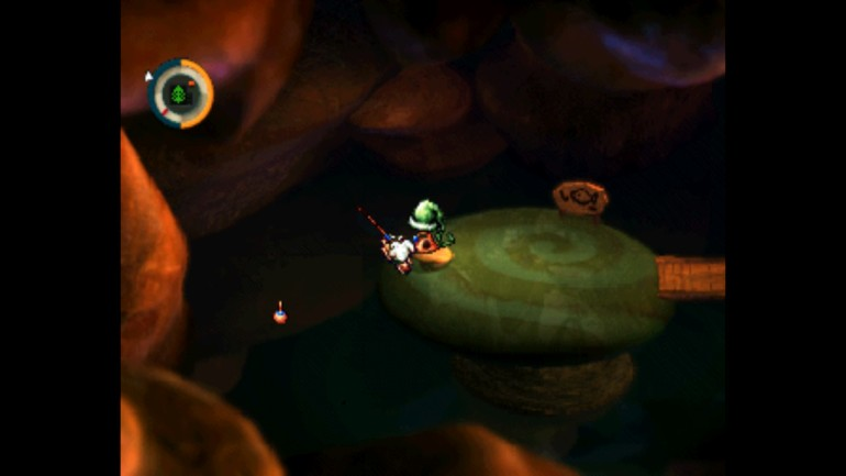 The protagonist of moon, sitting on a large mushroom and fishing off of it in a dark cave.