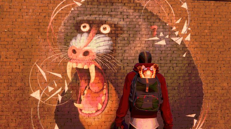 Miles Morales, in Spider-Man garb, with a backpack, out of which is emerging a cat in a mask, also named Spider-Man. They stand in front of a mural of a baboon baring its teeth.